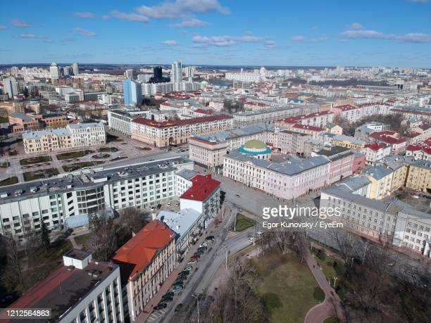 high angle view of street amidst buildings in city - minsk stock pictures, royalty-free photos & images