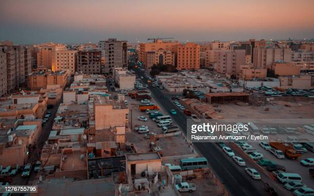 high angle view of street amidst buildings in city - doha stock pictures, royalty-free photos & images