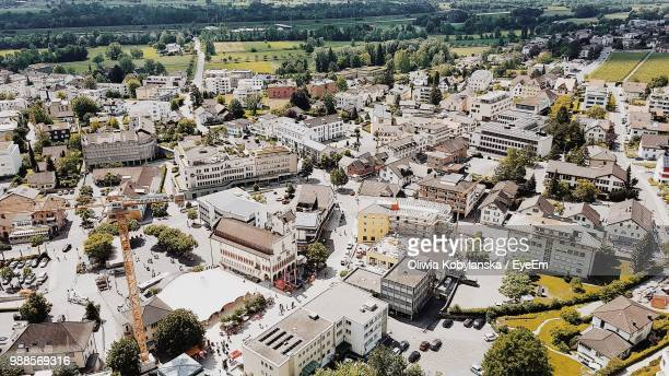 high angle view of street amidst buildings in city - vaduz stock pictures, royalty-free photos & images