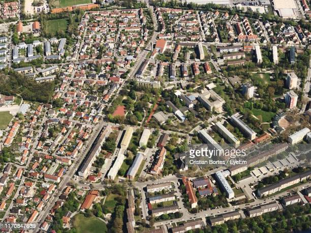high angle view of street amidst buildings in town - etalement urbain photos et images de collection