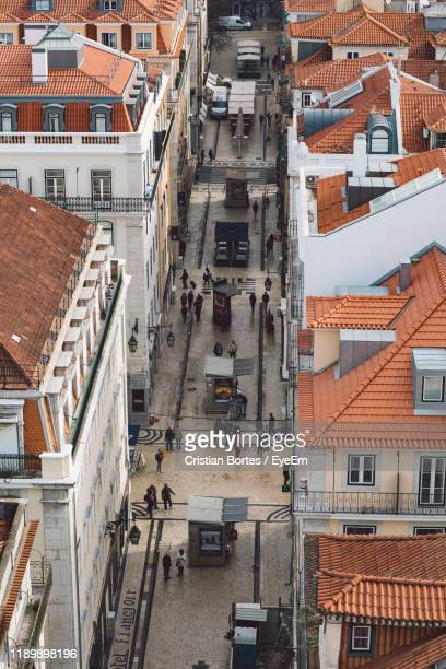 high angle view of street amidst buildings in town - bortes stock photos and pictures