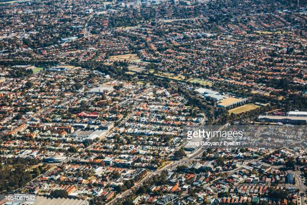 high angle view of street amidst houses in city - urban sprawl stock pictures, royalty-free photos & images