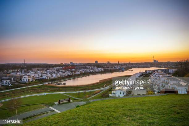high angle view of street and buildings against sky during sunset - dortmund city stock pictures, royalty-free photos & images