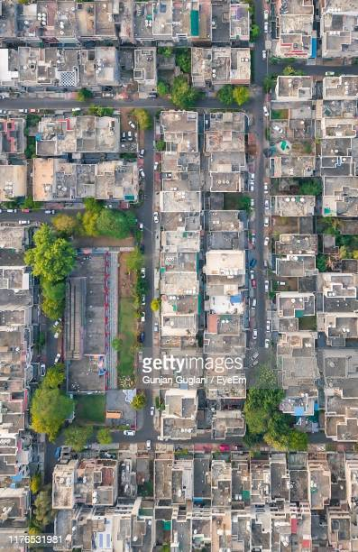 high angle view of street and buildings in city - new delhi stock-fotos und bilder