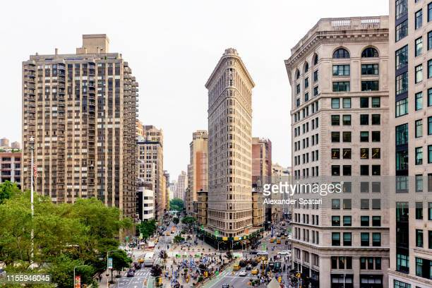 high angle view of street and flatiron building in new york, manhattan - manhattan new york city stock pictures, royalty-free photos & images