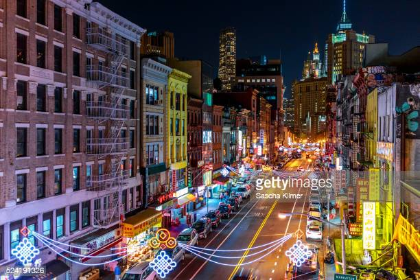 high angle view of street in china town, new york city - chinatown stock photos and pictures