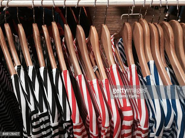 High Angle View Of Striped Patterned T-Shirts Hanging On Coathangers At Store