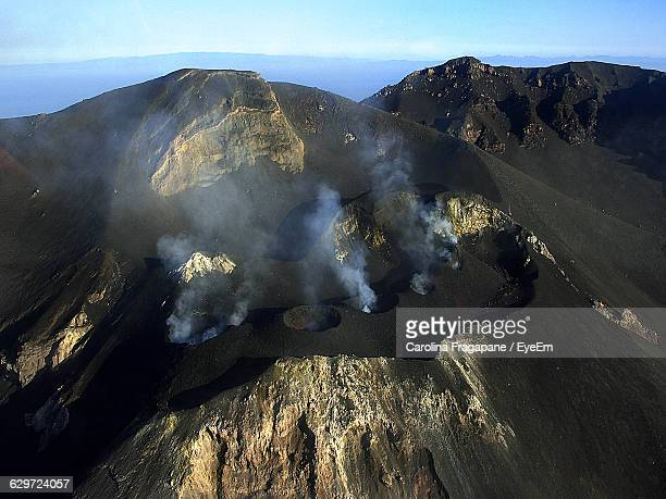 high angle view of stromboli volcano against sky - carolina fragapane stock pictures, royalty-free photos & images