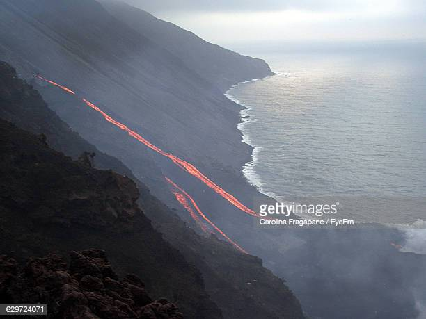high angle view of stromboli volcano by sea - carolina fragapane stock pictures, royalty-free photos & images