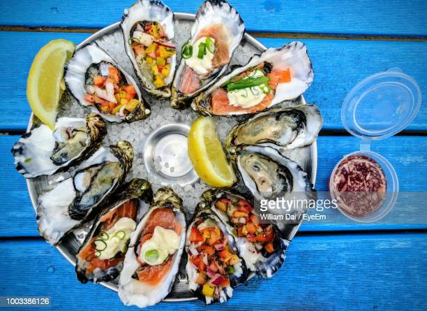 high angle view of stuffed oysters on plate at table - 魚介類 ストックフォトと画像