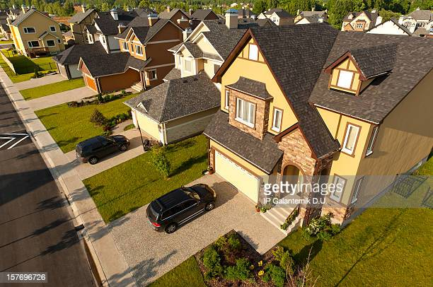High angle view of suburban houses and cars