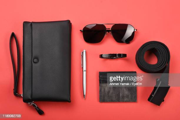 high angle view of sunglasses on table - riem persoonlijk accessoire stockfoto's en -beelden