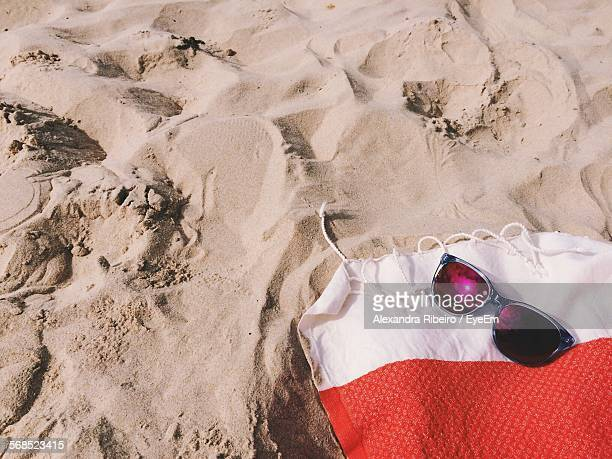 High Angle View Of Sunglasses On Towel