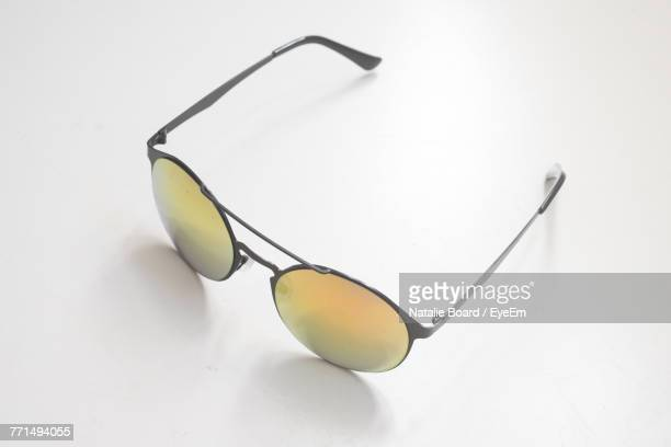 high angle view of sunglasses on white background - サングラス 無人 ストックフォトと画像