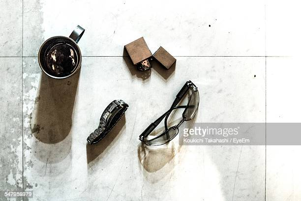 high angle view of sunglasses with tea cup on tiled floor - koukichi ストックフォトと画像