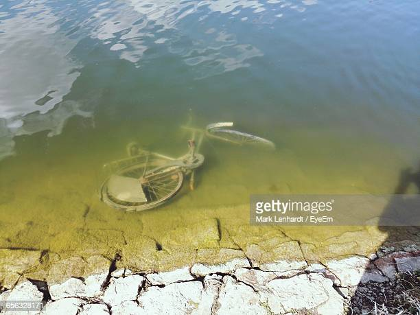 High Angle View Of Sunk Bicycle In Lake