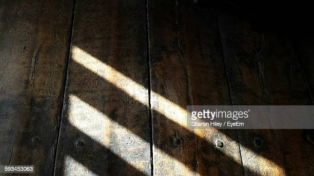 high angle view of sunlight falling on floorboard - floorboard stock photos and pictures