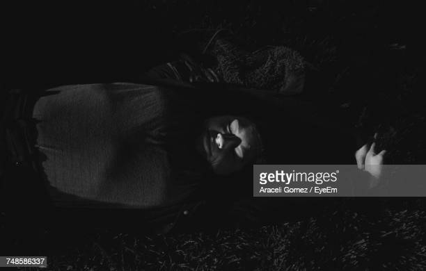 high angle view of sunlight falling on sleeping man - lying down photos et images de collection