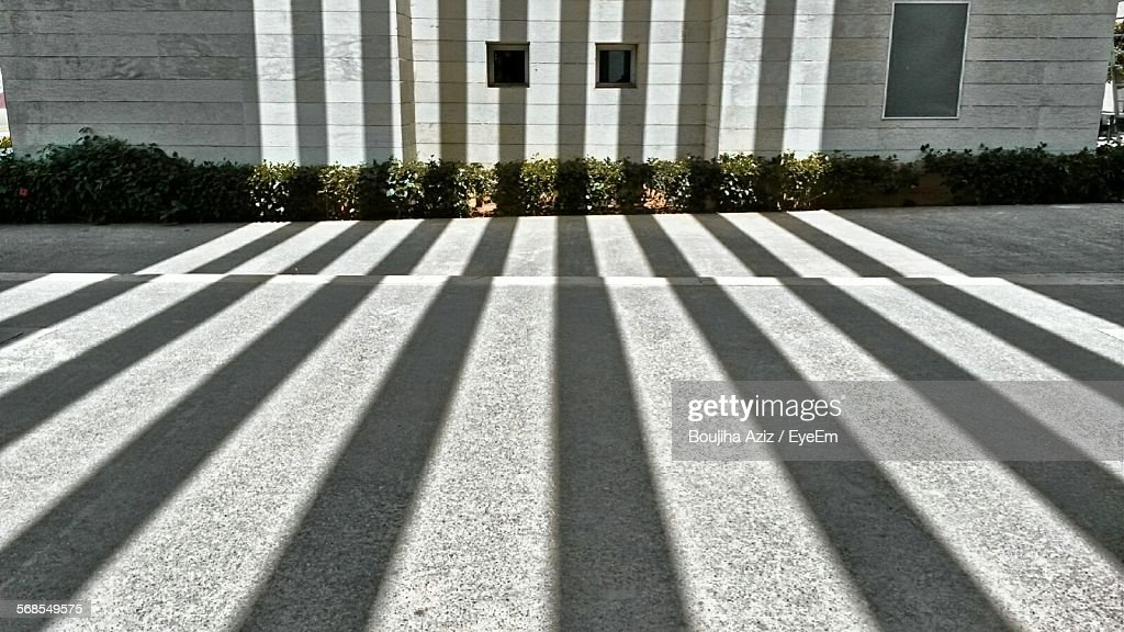 High Angle View Of Sunlight Falling On Street Against Building : Stock Photo