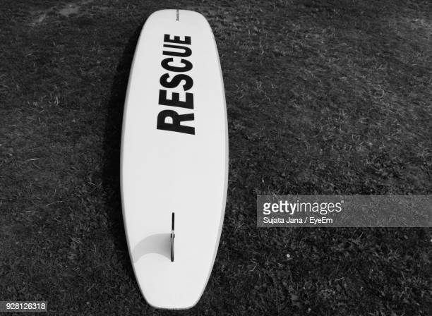 High Angle View Of Surfboard On Field