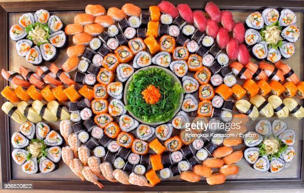 high angle view of sushi on table - grote groep dingen stockfoto's en -beelden