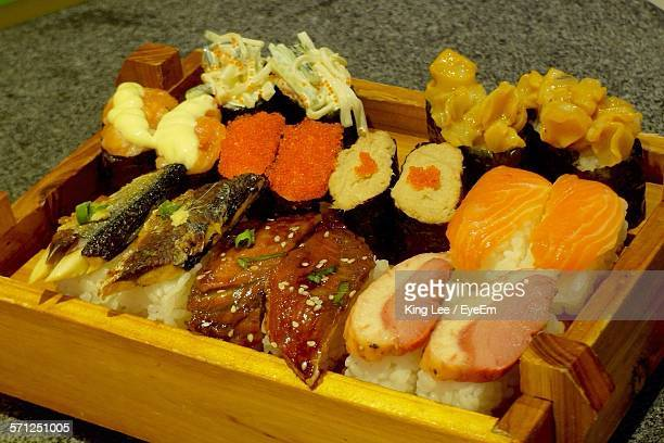 High Angle View Of Sushi Served In Wooden Plate On Table