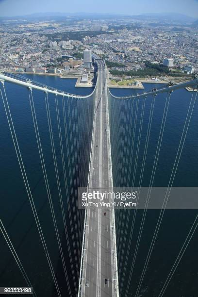High Angle View Of Suspension Bridge And Buildings In City
