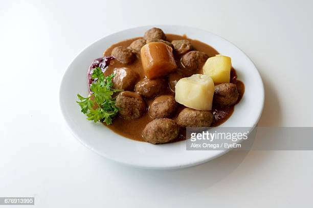 High Angle View Of Swedish Meatballs In Plate On White Background