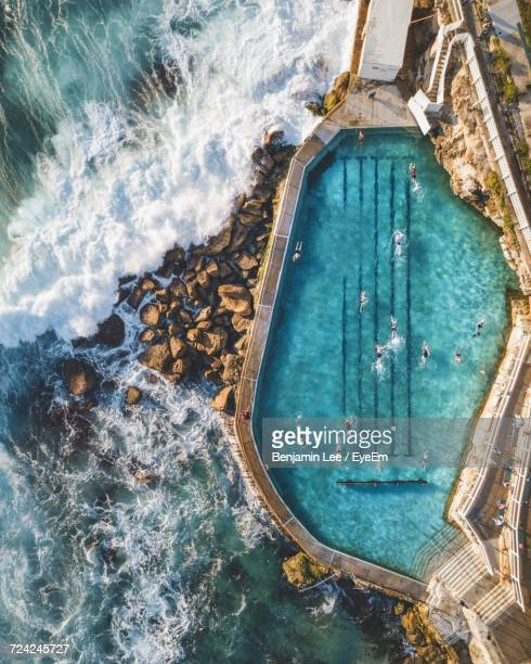 high angle view of swimming pool by sea - length stock photos and pictures