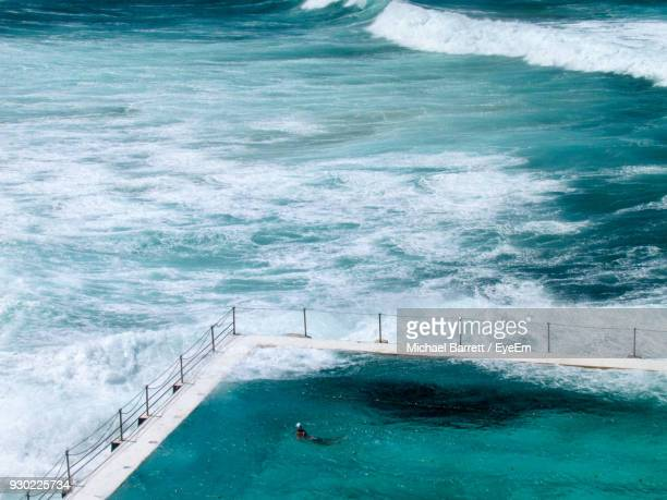 high angle view of swimming pool by sea - bondi beach stock pictures, royalty-free photos & images