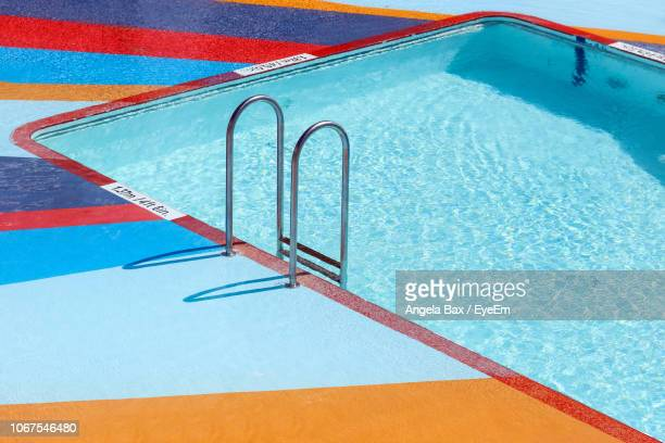 high angle view of swimming pool - poolside stock pictures, royalty-free photos & images