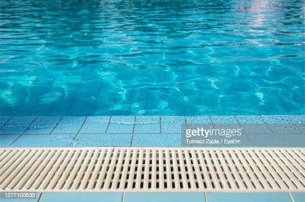 high angle view of swimming pool - swimming pool stock pictures, royalty-free photos & images