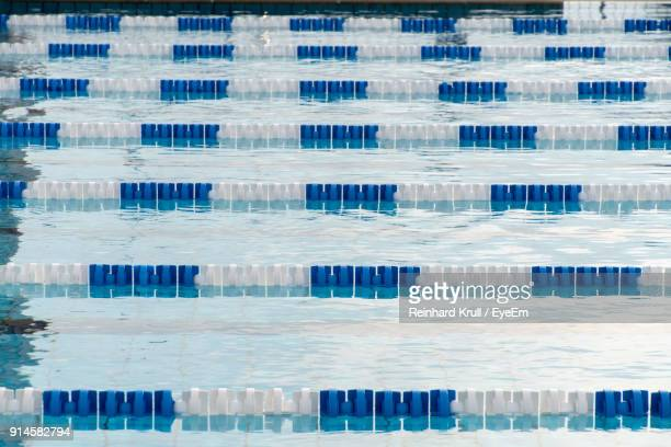 high angle view of swimming pool - length stock photos and pictures