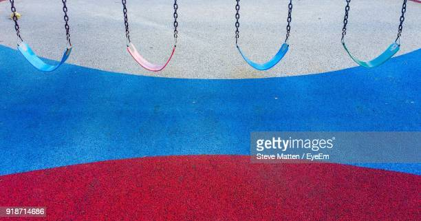 high angle view of swing at park - steve matten stock pictures, royalty-free photos & images