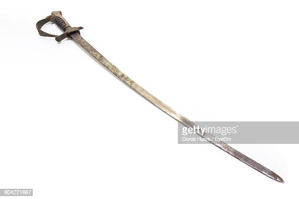 High Angle View Of Sword Against White Background