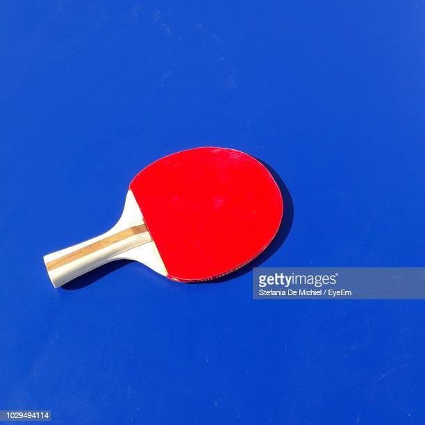 high angle view of table tennis racket on blue background - ラケット ストックフォトと画像