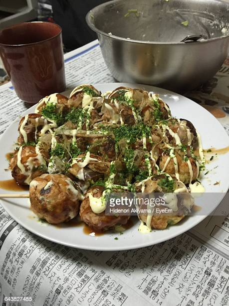High Angle View Of Takoyaki In Plate On Table