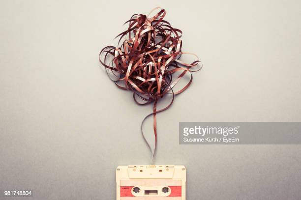 High Angle View Of Tangled Audio Cassette On Marble