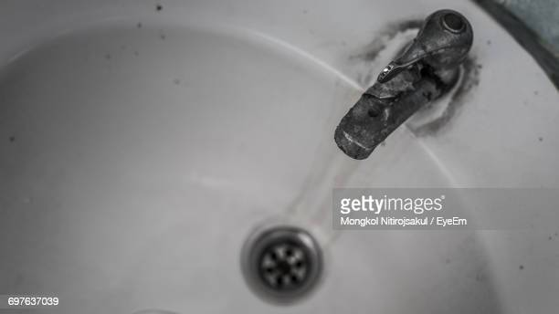 High Angle View Of Tap On Sink In Bathroom