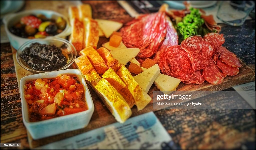 High Angle View Of Tapas On Cutting Board : Stock Photo