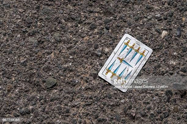 High Angle View Of Tarot Card On Footpath