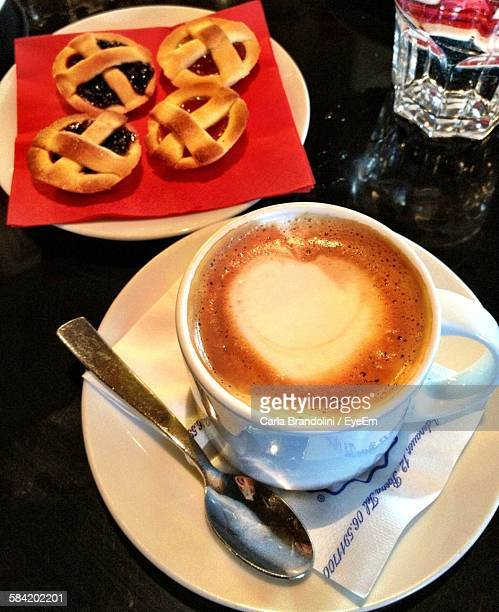 High Angle View Of Tarts And Coffee On Table