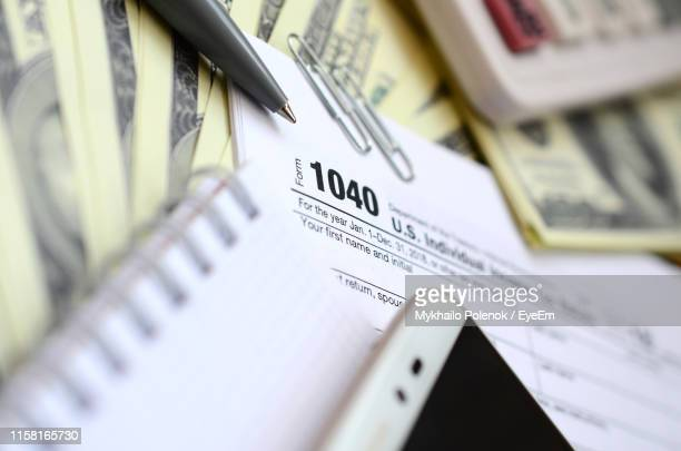 high angle view of tax forms and pen - irs stock pictures, royalty-free photos & images