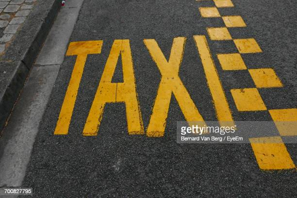 High Angle View Of Taxi Sign On Street