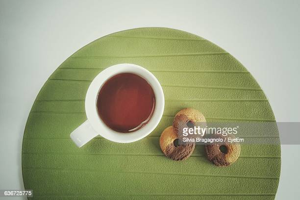 High Angle View Of Tea And Snacks