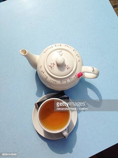 High Angle View Of Tea In Cup With Teapot On Table