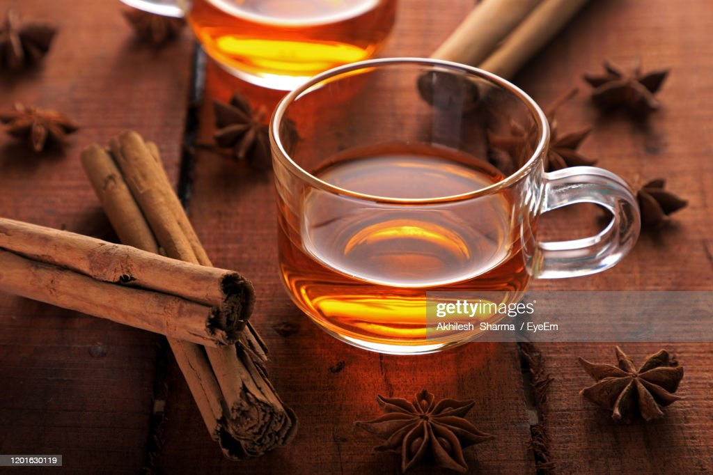 High Angle View Of Tea In Cups By Spices On Table : Stock Photo