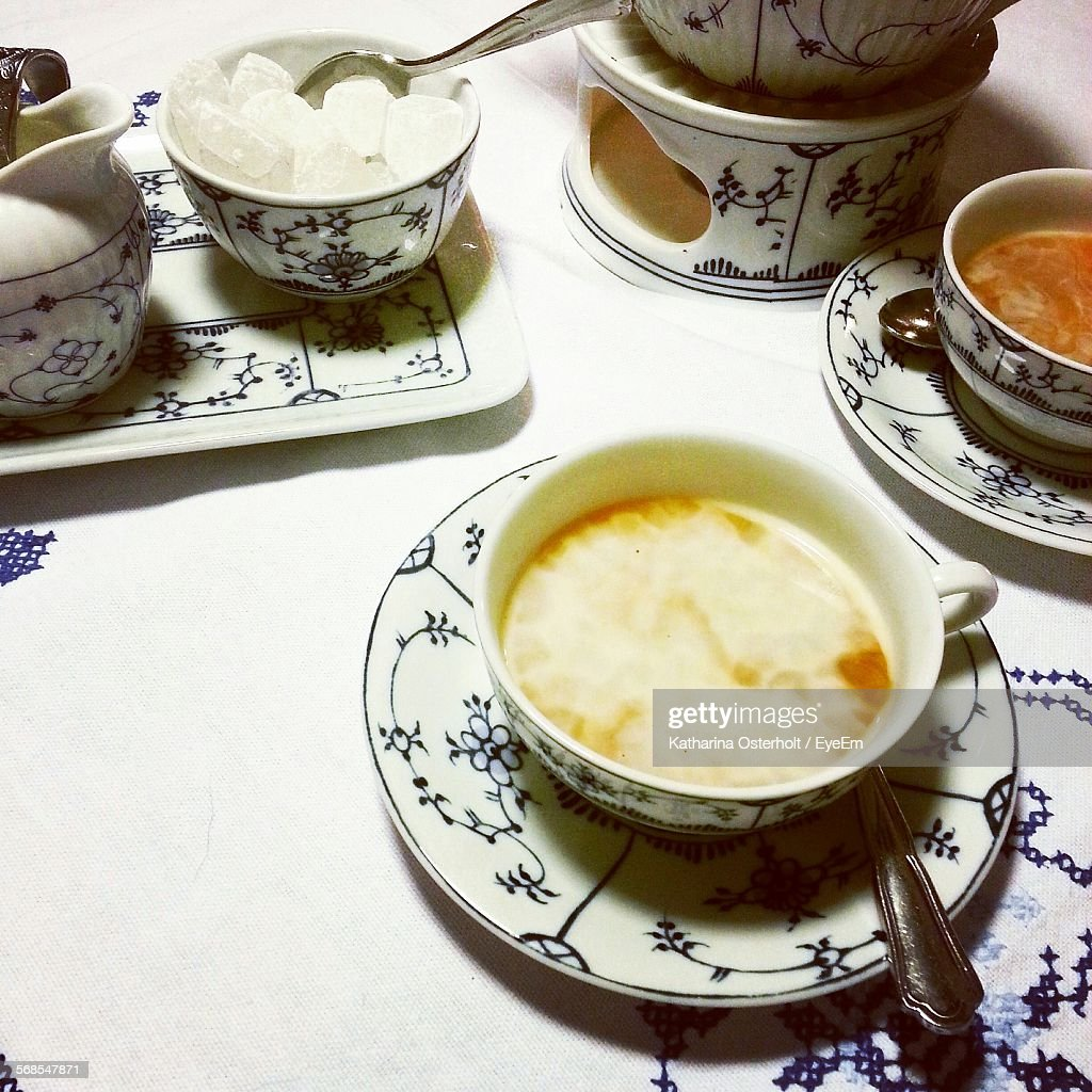 High Angle View Of Tea In Porcelain Crockery With Sugar : Stock Photo