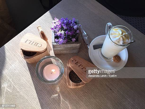 High Angle View Of Tea Light Candle By Dessert On Table