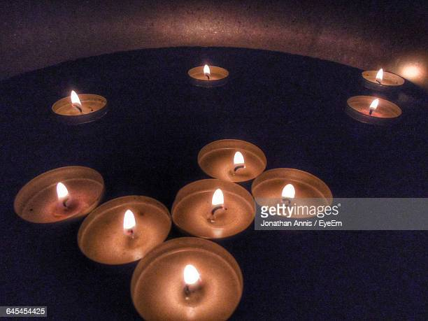 High Angle View Of Tea Light Candles Floating In Water